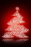 Sparkling Christmas tree with white snowflakes Royalty Free Stock Photos