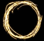 Sparkling circle frame. Circle sketch frame made of sparkler. Isolated on a black background Royalty Free Stock Photos