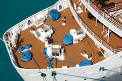 A sparkling clean deck with huge coils of rope and cables Royalty Free Stock Photography
