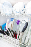 Sparkling clean dishes in the dishwasher Stock Images