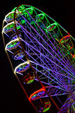 Sparkling colored lights, a huge carousel. Royalty Free Stock Images