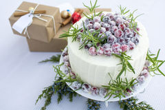 Sparkling Cranbery White Chocolate Cake with gift boxes backgrou Royalty Free Stock Photo