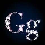 Sparkling diamond gemstone letter G Royalty Free Stock Images