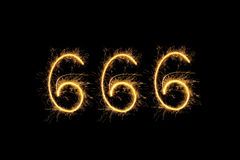 Sparkling digits 666. Isolated on black background. Hell, death and satan symbol royalty free stock photo