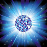 Sparkling disco ball on blue light burst Royalty Free Stock Images