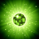 Sparkling disco ball on green light burst Stock Image