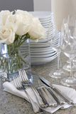 Sparkling dishes for home entertaining. Sparkling white dishes for elegant home entertaining Stock Photography