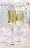 Sparkling Festive Champagne Sparkling, skoal. Two elegant flutes of sparkling white champagne with lots of bubbles on festive background, celebration concept Stock Images