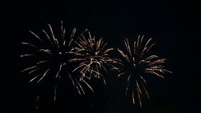 Sparkling fiery sparks of festive fireworks in the night sky. time laps. Close-up stock video footage
