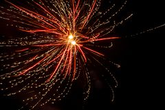 Sparkling fireworks in the dark night. stock image