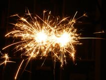 Sparkling fireworks during the holiday season. Happy new year royalty free stock photo