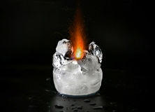 Sparkling flame melting ice. Background black burn burning closeup cold contrast element elements fire flame frozen heat hot ice icy isolated melt melting Royalty Free Stock Image