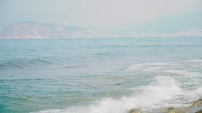 Sparkling fresh wavy water is shining on a sunny summer day at the seaside.  stock video footage