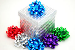 Sparkling Gift Box and Bows. A sparkling silver gift box with  many colored bows Royalty Free Stock Image