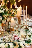 Sparkling glassware stands on table prepared for elegant wedding. Stock Photo