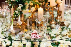 Sparkling glassware stands on table prepared for elegant wedding Stock Images