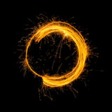 Sparkling Glowing Fire Circle on Black Background Stock Photo