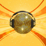 Sparkling gold disco ball and headphones Stock Photo