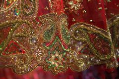 Sparkling gold embroidery, green and colorful sequins, stones, r. Hinestones closeup royalty free stock photos