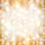 Sparkling golden Christmas party lights background. Background of defocused golden lights with sparkles. Christmas, New Years, disco party Royalty Free Stock Photo