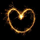 Sparkling golden heart isolated on black background. Beautiful Sparkling golden heart isolated on black background. Glowing Outline of a heart shape to overlay Royalty Free Stock Photo