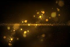 Sparkling golden particles on dark stock photos