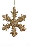 Sparkling Golden Snowflake. Christmas golden glitter snowflake decoration on a white background Royalty Free Stock Image