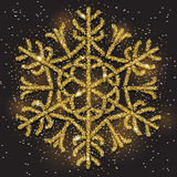 Sparkling golden snowflake with glitter texture for Christmas, New Year greeting card. Royalty Free Stock Image