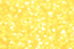 Sparkling golden yellow background for Holiday or celebration. Sparkling golden yellow background.  Celebrate Holiday or festive celebration with this beautiful Royalty Free Stock Photo