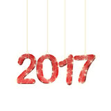Sparkling 2017. Hanging on thin ropes on white background Royalty Free Stock Image