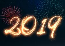 Sparkling Happy New Year 2019 Fireworks. Happy New Year 2019 written with sparkle fireworks displayed on a dark night sky. Shiny bright glowing festive holiday Stock Photography