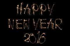 Sparkling happy new year 2016 text on black background Stock Photos