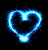 Sparkling Heart. Sparkling blue heart shape isolated on black background Royalty Free Stock Photos