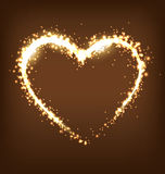 Sparkling heart on brown Royalty Free Stock Image