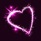 Sparkling heart on dark background Royalty Free Stock Photography