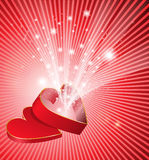 Sparkling heart. Red open box in the shape of a heart from which flows a flickering light Royalty Free Stock Photos
