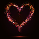 Sparkling heart shape. On dark background Royalty Free Stock Images