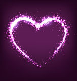 Sparkling heart on violet. Background Stock Photos