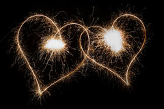 Sparkling Hearts. Two sparkling hearts isolated on black Royalty Free Stock Photo