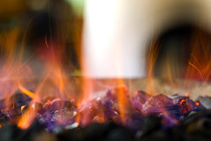 Sparkling hot coals. Background of hot live coals with sparkles. Can be combined with concepts of grilling and barbecue as well as heat and heating or even royalty free stock photos