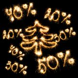 Sparkling inscription of 50%, 40%,30%, 20% with christmas tree o Royalty Free Stock Photography