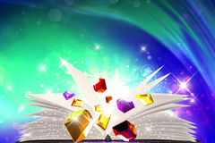 Sparkling jewels going out from a book royalty free stock photography