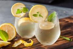 Sparkling lemonade with lemon and mint. On dark background royalty free stock photo