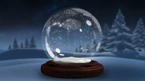 Sparkling light spirally moving around the snow globe