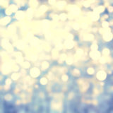 Sparkling Lights Festive background with texture. Abstract Chris. Tmas twinkled bright background with bokeh defocused silver and golden lights Stock Photography