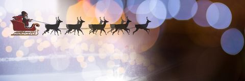 Sparkling lights transition of Santa`s sleigh and reindeer`s. Digital composite of Sparkling lights transition of Santa`s sleigh and reindeer`s Royalty Free Stock Images
