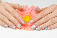 Sparkling manicure and a pink flower Royalty Free Stock Images