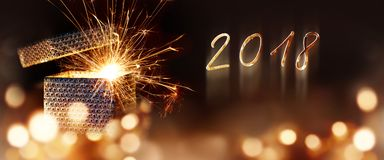 Sparkling new year surprise. With golden year number 2018 Royalty Free Stock Images