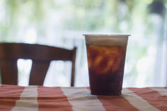 Sparkling Nitro Cold Brew Coffee. On table indoor cafe ready to drink Stock Images