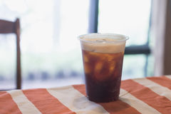 Sparkling Nitro Cold Brew Coffee. On table indoor cafe ready to drink Stock Photography